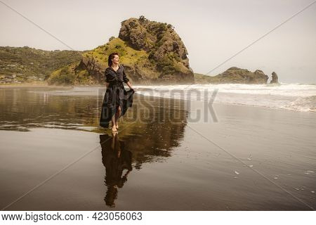 young happy woman on natural background, walking