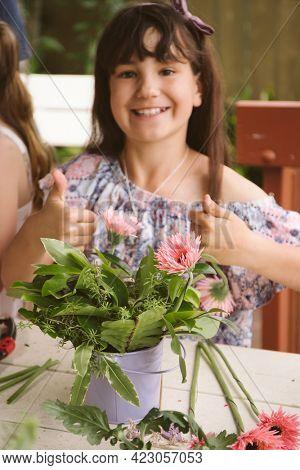 girl at floral workshop, kids birthday party, creating flower arrangements