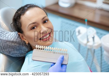 Brunette Woman With Beautiful Smile Before Receiving Dental Care Check Up And Teeth Whitening Bleach