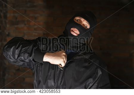A Bandit, A Terrorist, A Criminal In A Black Mask Holds A Knife Near His Throat, Makes A Grimace And