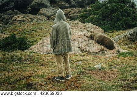 young boy with a dog on natural background
