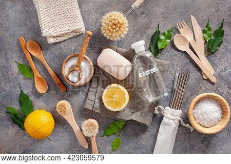 zero waste eco friendly cleaning kitchen concept. wooden brushes, lemon, baking soda, vinegar, drinking straw