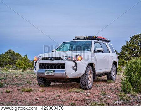 Dinosaur National Monument, CO, USA - May 18, 2021: Toyota 4Runner SUV (2016 Trail model) at dawn in arid landscape of north western Colorado along Yampa Bench Road, springtime morning scenery.