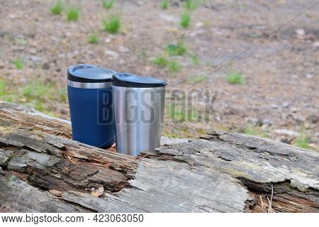 Tourist Food For Outdoor Activities. Two Metal Thermo Cups On A Forest Background. Enjoy A Tasty Foo