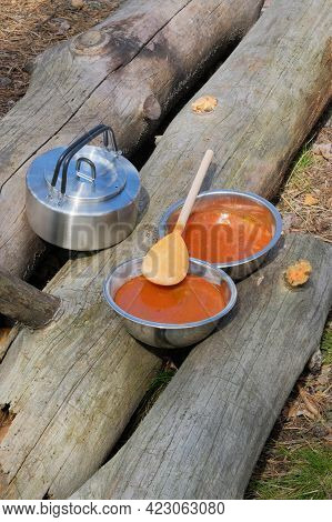Traveler Is Eating Soup During Camping. Enjoy A Tasty Food During Hiking Trips. Tourist Food For Out