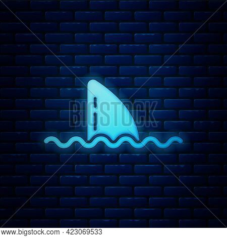 Glowing Neon Shark Fin In Ocean Wave Icon Isolated On Brick Wall Background. Vector