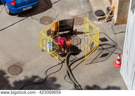 Saint Petersburg, Russia - June 08, 2021: A Worker During Work On The Repair Of Water And Sewer Pipe