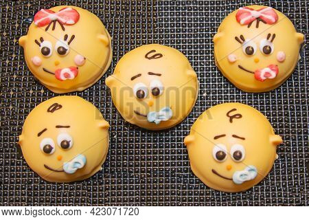 Round-shaped Cookies Of Yellow Color In The Form Of Smile Children's Faces On The Background Of A Br