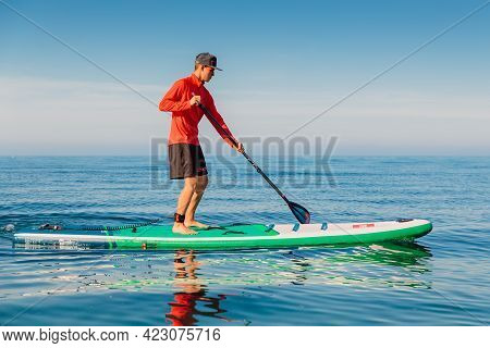 May 28, 2021. Anapa, Russia. Sporty Man On Stand Up Paddle Board At Blue Sea. Vacation On Sup Board