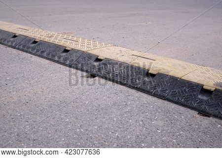 Speed Bump On An Asphalt Road, Speed Breaker, Road Bumps In The Middle Of The Road
