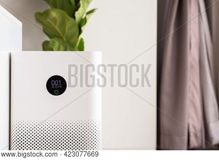 White Modern Air Purifier In A Living Room For Refresh Air Flow At Home,advanced Air Purifying And P