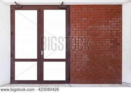 The Large Entrance Door Brown Solid Wood Building And The Red-brown Brick Wall