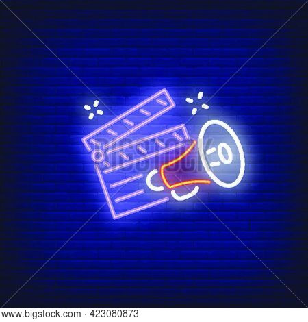 Clapper Board And Megaphone Neon Sign. Luminous Signboard With Film Director Belongings. Night Brigh