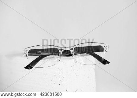 Stylish Eyeglasses On Trendy Stone. Optical Store, Glasses Selection, Eye Test, Vision Examination A