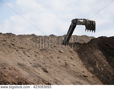 Excavator Works On A Dump In Open Pit Mining. Heavy Construction Equipment. Quarry Mining.