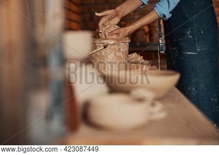 Woman Hands Preparing Earthenware Materials Above The Table In Art Studio