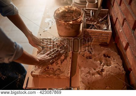 Female Hands Squeezing Earthenware Materials For Modeling Ceramic Product In Art Studio
