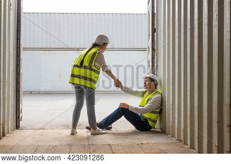 Young Adult Men And Women Industrial Worker Holding Hand, Encourage And Cheer Up After Hard Working