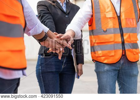 Unidentified Group Of Multi Mix Race Worker With Supervisor  Holding Hand To Cheer Up And Encourage