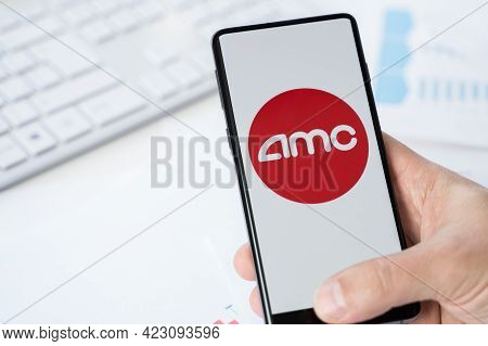 Russia Moscow 30.05.21 Mobile Phone With Logo Of Amc Online Cinemas Network. Entertainment Holdings.