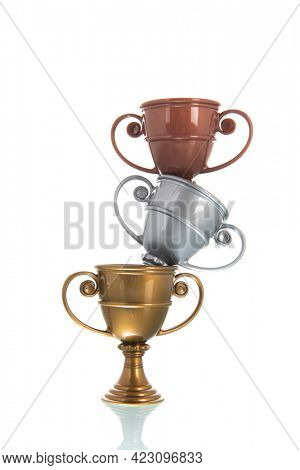 Golden, silver and bronze cup isolated over white background