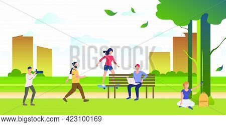 People Doing Sports, Relaxing And Taking Photos In City Park. Relaxation, Activity, Lifestyle Concep