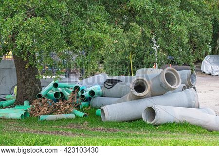 Loose Pile Of Large Drainage Pipes On Side Of Street In Uptown Neighborhood Of New Orleans