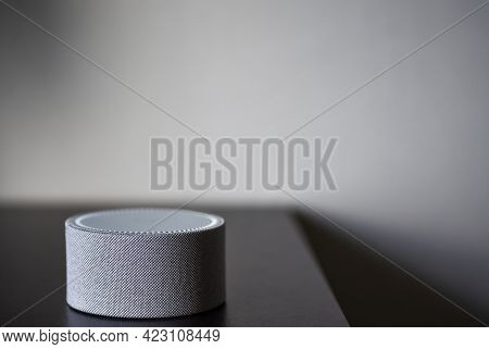Smart Speaker With Voice Assistant On The Table.