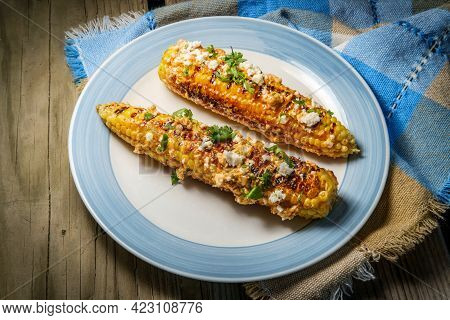 Mexican Street Corn Also Known As Elote Served With Chili Mayonnaise And Cotija Cheese
