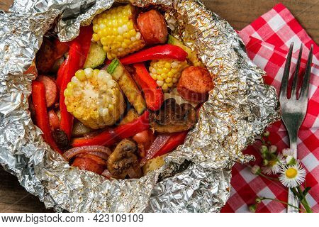 Grilled Barbecue Kielbasa Foil Packet With Corn On The Cob