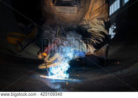 A Welder Welds Large Diameter Pipes With Manual Electric Arc Welding.