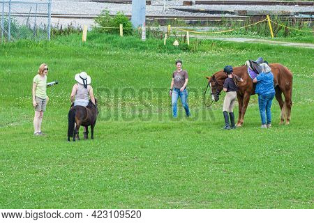 New Orleans, La - May 26: People With Horses Along The Levee In Uptown Neighborhood On May 26, 2021