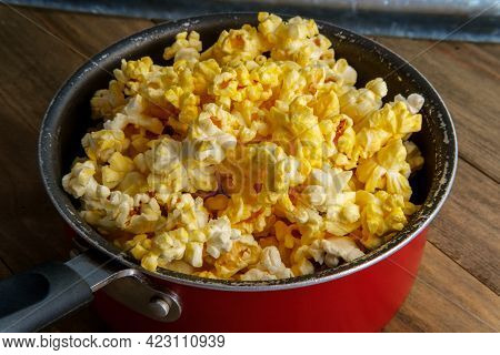 Homemade Theater Popcorn With Butter In Wooden Bowl For Movie Night