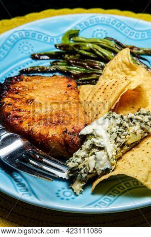 Marinated Char-grilled Pork Chops With Green Beans And Artichoke Spinach Dip