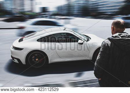 Kiev, Ukraine - May 22, 2021: White Supercar Porsche 911 Carrera 4s In Motion. High Speed. Porsche I