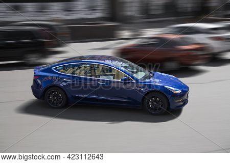 Kiev, Ukraine - May 22, 2021: Tesla Model 3 In Motion. Electric Car On The Road