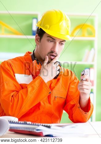 Construction supervisor planning new project in office