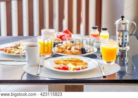 Breakfast Buffet In Luxury Hotel, Omelette And Fresh Desserts, Buns, Croissant. Dining Table With Pl