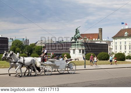 Vienna, Austria - June 17 2018: Carriage Passing In Front Of The Statue Of Archduke Charles On The H
