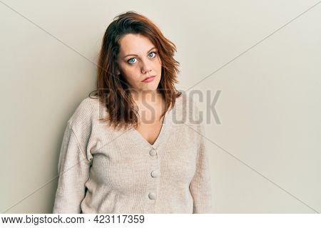 Young caucasian woman wearing casual clothes looking sleepy and tired, exhausted for fatigue and hangover, lazy eyes in the morning.