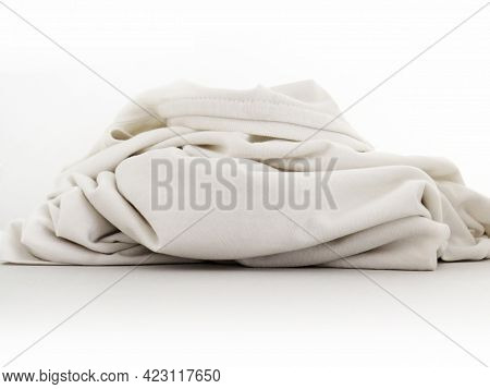 Front View Of Piece Of Wrinkled White Cloth On White Background. Close Up Of Part Of White T-shirt I