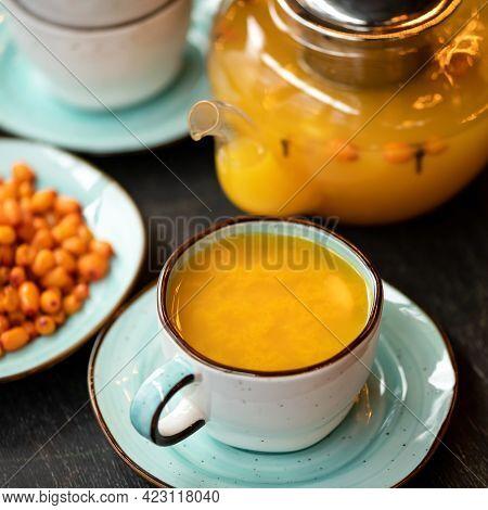 Full Cup Of Orange Sea Buckthorn Tea, Close-up Shot. Vitamin Healthy Drink Useful For Strengthening