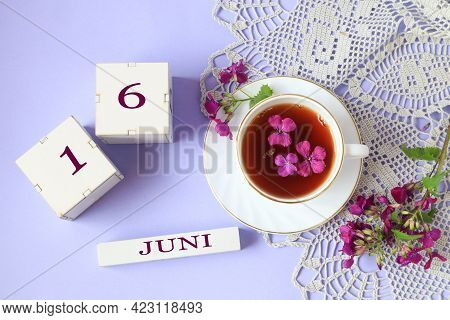 Calendar For June 16: Cubes With The Number 16, The Name Of The Month Of June In English, A Cup Of T