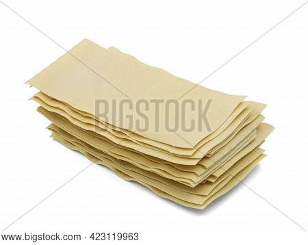 Uncooked Stacked Lasagne Sheets Isolated On White Background