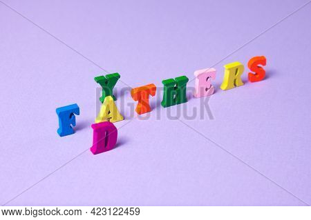 Child's Toy Letters Spelling Fathers Day On Purple Background