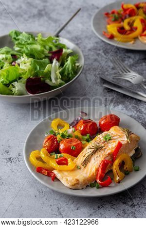 Baked Fillet Arctic Char On A Plate With Vegetables
