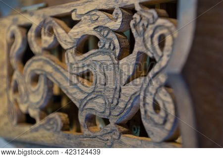 An Image Of A Dragon Carved From Wood - An Ancient Novgorod Ornament - On The Lid Of A Hand-made Fol