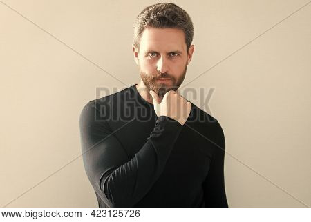 Will The Beard Trend Continue. Serious Mature Man Touch Unshaven Chin. Bearded Man Isolated On White