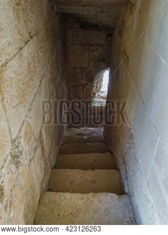 Corridor With Stairs Between Levels Inside Medieval Tower Of Fortress Kizkalesi. There Are Very Tigh