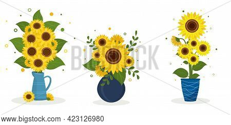A Set Of Three Sunflower Bouquets In A Blue Jug, A Blue Round Vase And A Blue Vase With White Stripe